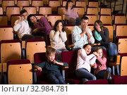Audience attending movie night for horror. Стоковое фото, фотограф Яков Филимонов / Фотобанк Лори