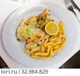 Купить «Delicious grilled cuttlefish on plate, served with french fries», фото № 32984829, снято 4 апреля 2020 г. (c) Яков Филимонов / Фотобанк Лори