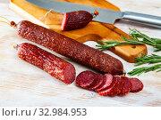 Купить «Raw smoked salami with fresh rosemary», фото № 32984953, снято 4 апреля 2020 г. (c) Яков Филимонов / Фотобанк Лори