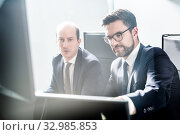 Купить «Business team analyzing data at business meeting in modern corporate office.», фото № 32985853, снято 10 января 2020 г. (c) Matej Kastelic / Фотобанк Лори