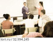 Купить «schoolgirl solves task near blackboard in classroom mathematics», фото № 32994245, снято 21 февраля 2020 г. (c) Татьяна Яцевич / Фотобанк Лори