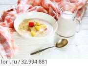 Купить «Yogurt with flax seeds, grapefruit, raspberries and orange on a white background», фото № 32994881, снято 28 января 2020 г. (c) Марина Володько / Фотобанк Лори