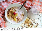 Купить «Yogurt with flax seeds, grapefruit, raspberries and orange on a white background», фото № 32994889, снято 28 января 2020 г. (c) Марина Володько / Фотобанк Лори