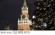 Купить «Christmas (New Year holidays) decoration in Moscow (at night), Russia-- The Spasskaya Tower. Journey to Christmas, Moscow seasons. View from Zaryadye Park.», видеоролик № 32995613, снято 28 января 2020 г. (c) Владимир Журавлев / Фотобанк Лори