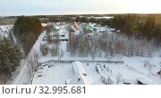Купить «Aerial view at small village with summer cottages in northern Karelia in Russia. Countryside covered with snow at winter season», видеоролик № 32995681, снято 20 января 2020 г. (c) Кекяляйнен Андрей / Фотобанк Лори