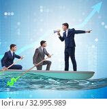 The team of businessmen in teamwork concept with boat. Стоковое фото, фотограф Elnur / Фотобанк Лори