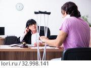 Купить «Disabled man consulting judge for damages litigation», фото № 32998141, снято 6 мая 2019 г. (c) Elnur / Фотобанк Лори