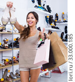 Купить «young woman in shoes store», фото № 33000185, снято 17 февраля 2020 г. (c) Яков Филимонов / Фотобанк Лори