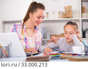 Young female helping to do lessons. Стоковое фото, фотограф Яков Филимонов / Фотобанк Лори