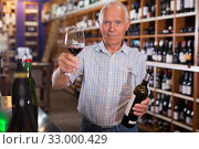 Senior male tasting wines in winery. Стоковое фото, фотограф Яков Филимонов / Фотобанк Лори