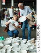 Купить «Pensioner family buys vintage dishes at a flea market», фото № 33000465, снято 11 мая 2019 г. (c) Яков Филимонов / Фотобанк Лори
