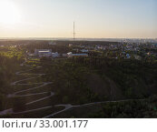 Купить «Aerial top vew of winding road in the city», фото № 33001177, снято 28 июля 2019 г. (c) Jan Jack Russo Media / Фотобанк Лори