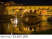 Купить «Старинный Золотой мост поздним вечером. Флоренция, Италия», фото № 33001265, снято 19 сентября 2017 г. (c) Виктор Карасев / Фотобанк Лори