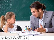 Купить «Teacher with young girl in the classroom», фото № 33001681, снято 6 августа 2019 г. (c) Elnur / Фотобанк Лори