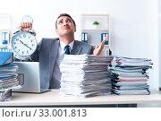 Купить «Businessman with heavy paperwork workload», фото № 33001813, снято 26 июня 2019 г. (c) Elnur / Фотобанк Лори