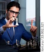 Купить «Businessman playing chess in strategy concept», фото № 33002321, снято 9 октября 2017 г. (c) Elnur / Фотобанк Лори