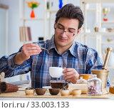 Купить «Professional tea expert trying new brews», фото № 33003133, снято 19 апреля 2017 г. (c) Elnur / Фотобанк Лори