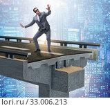 Купить «Businessman in uncertainty concept with broken bridge», фото № 33006213, снято 20 февраля 2020 г. (c) Elnur / Фотобанк Лори