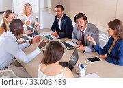 Купить «Business partners discussing in office», фото № 33006489, снято 31 мая 2020 г. (c) Яков Филимонов / Фотобанк Лори