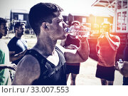 Купить «Men drinking after the effort», фото № 33007553, снято 7 июня 2020 г. (c) Wavebreak Media / Фотобанк Лори