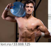 Muscular ripped man with big water bottle. Стоковое фото, фотограф Elnur / Фотобанк Лори