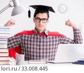 Купить «Super hero student wearing a mortarboard studying for exams», фото № 33008445, снято 22 декабря 2016 г. (c) Elnur / Фотобанк Лори