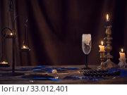 Купить «fortune telling with candle wax and water», фото № 33012401, снято 27 января 2020 г. (c) Майя Крученкова / Фотобанк Лори