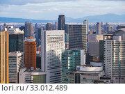 The Herbis Plaza in the skyscraper center in front of JR Osaka Station. Osaka. Japan (2019 год). Редакционное фото, фотограф Serg Zastavkin / Фотобанк Лори