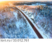 Купить «Sunset light over the Kola highway, aerial view at northern road during polar night. Karelia, Russia», фото № 33012761, снято 28 декабря 2019 г. (c) Кекяляйнен Андрей / Фотобанк Лори