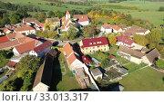 Купить «Aerial view of typical village Cakov in the Czech Republic», видеоролик № 33013317, снято 12 октября 2019 г. (c) Яков Филимонов / Фотобанк Лори