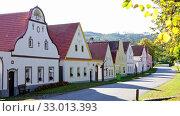 Купить «Rural landscape of small historic village of Holasovice on sunny autumn day, Czech Republic», видеоролик № 33013393, снято 14 июля 2020 г. (c) Яков Филимонов / Фотобанк Лори