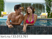 Купить «Happy young couple relaxing in the swimming pool», фото № 33013761, снято 28 ноября 2019 г. (c) Wavebreak Media / Фотобанк Лори