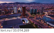 Купить «Scenic aerial view of modern neighborhood of Barcelona in night lights», видеоролик № 33014269, снято 20 марта 2019 г. (c) Яков Филимонов / Фотобанк Лори
