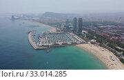 Купить «Panoramic view from the drone of coastline and beach of Barcelona. Spain», видеоролик № 33014285, снято 7 июля 2019 г. (c) Яков Филимонов / Фотобанк Лори