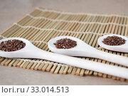 Купить «Flax seeds on three wooden spoons on the table», фото № 33014513, снято 19 октября 2019 г. (c) Катерина Белякина / Фотобанк Лори