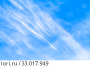 Blue sky with cirrus clouds at daytime. Natural background texture. Стоковое фото, фотограф EugeneSergeev / Фотобанк Лори