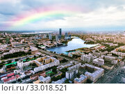 Купить «Rainbow over the city. Aerial view of the city center of Yekaterinburg. Russia», фото № 33018521, снято 20 июля 2019 г. (c) Евгений Ткачёв / Фотобанк Лори