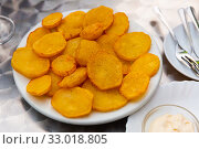 Купить «Tasty cooked baked in oven spicy potatoes served at plate», фото № 33018805, снято 26 мая 2020 г. (c) Яков Филимонов / Фотобанк Лори