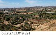 Купить «Valley with olive trees and rural houses. Cyprus», видеоролик № 33019821, снято 2 февраля 2020 г. (c) Володина Ольга / Фотобанк Лори