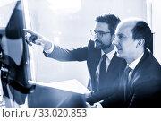 Купить «Business team analyzing data at business meeting in modern corporate office.», фото № 33020853, снято 10 января 2020 г. (c) Matej Kastelic / Фотобанк Лори