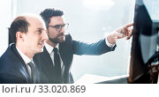 Купить «Business team analyzing data at business meeting in modern corporate office.», фото № 33020869, снято 10 января 2020 г. (c) Matej Kastelic / Фотобанк Лори