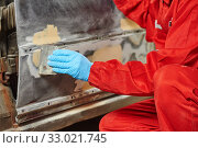 Купить «automobile body spackling with plaster filler. Repair car service», фото № 33021745, снято 21 мая 2015 г. (c) Дмитрий Калиновский / Фотобанк Лори
