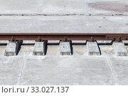 Купить «Rusty rail on concrete sleepers», фото № 33027137, снято 29 июня 2019 г. (c) EugeneSergeev / Фотобанк Лори