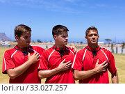 Soccer players singing. Стоковое фото, агентство Wavebreak Media / Фотобанк Лори