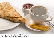 Купить «Pancake served with full cup of coffee and jam», фото № 33027361, снято 31 января 2017 г. (c) Гурьянов Андрей / Фотобанк Лори