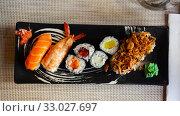 Купить «Japanese sushi platter», фото № 33027697, снято 20 февраля 2020 г. (c) Яков Филимонов / Фотобанк Лори