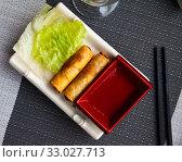 Купить «Fried spring rolls served with lettuce», фото № 33027713, снято 16 июля 2020 г. (c) Яков Филимонов / Фотобанк Лори