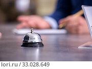 Купить «Hotel reception bell at the counter», фото № 33028649, снято 13 июня 2019 г. (c) Elnur / Фотобанк Лори