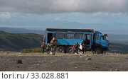 Купить «Group of travelers unloads off-road extreme expedition truck in mountains for vacation and camping in popular travel destinations. Kamchatka Peninsula», видеоролик № 33028881, снято 30 августа 2019 г. (c) А. А. Пирагис / Фотобанк Лори