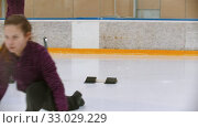 Купить «Curling training on ice rink - a young woman pushes off from the stand with a stone biter», видеоролик № 33029229, снято 5 июня 2020 г. (c) Константин Шишкин / Фотобанк Лори